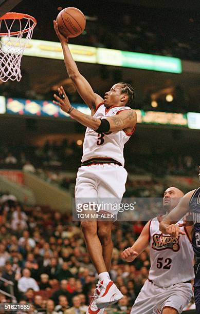 The Philadelphia 76ers' guard Allen Iverson goes up to the basket against the Sacramento Kings in Philadelphia 24 February Iverson scored 36 points...