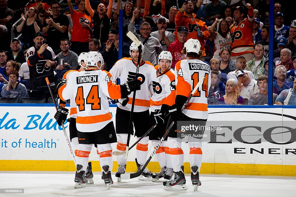 The Philadelphia Flyers celebrate after <a gi-track='captionPersonalityLinkClicked' href=/galleries/search?phrase=Claude+Giroux&family=editorial&specificpeople=537961 ng-click='$event.stopPropagation()'>Claude Giroux</a> #28 of the Philadelphia Flyers scores a goal during the second period of the game against the Tampa Bay Lightning at the Tampa Bay Times Forum on March 18, 2013 in Tampa, Florida.