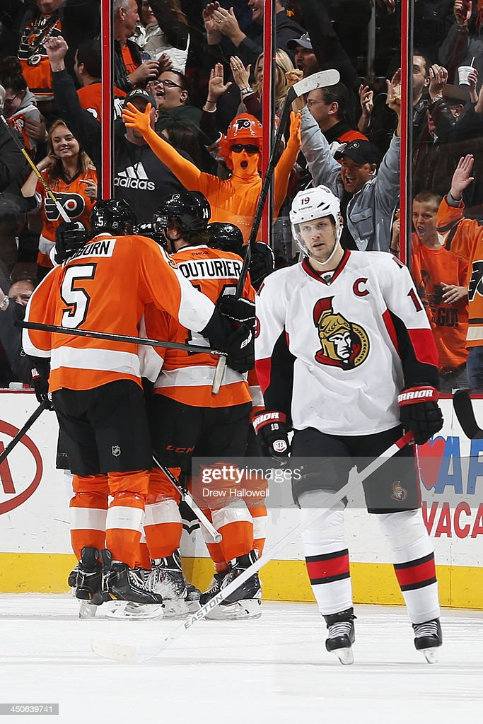 The Philadelphia Flyers celebrate Kimmo Timonen's #44 of the Philadelphia Flyers go ahead goal in the third period as Jason Spezza #19 of the Ottawa Senators skates way at the Wells Fargo Center on November 19, 2013 in Philadelphia, Pennsylvania. The Flyers won 5-2.