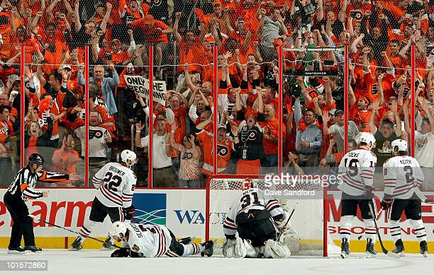 The Philadelphia Flyers fan cheer after Daniel Briere scores a first period goal against the Chicago Blackhawks during Game Three of the 2010 NHL...