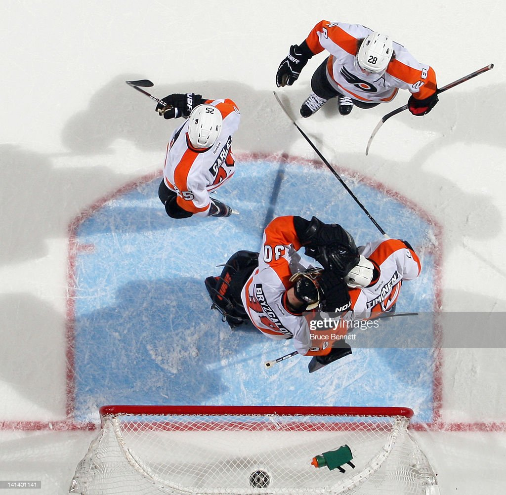 The Philadelphia Flyers line up to congratulate <a gi-track='captionPersonalityLinkClicked' href=/galleries/search?phrase=Ilya+Bryzgalov&family=editorial&specificpeople=2285430 ng-click='$event.stopPropagation()'>Ilya Bryzgalov</a> #30 on a 3-2 victory over the New York Islanders at the Nassau Veterans Memorial Coliseum on March 15, 2012 in Uniondale, New York.