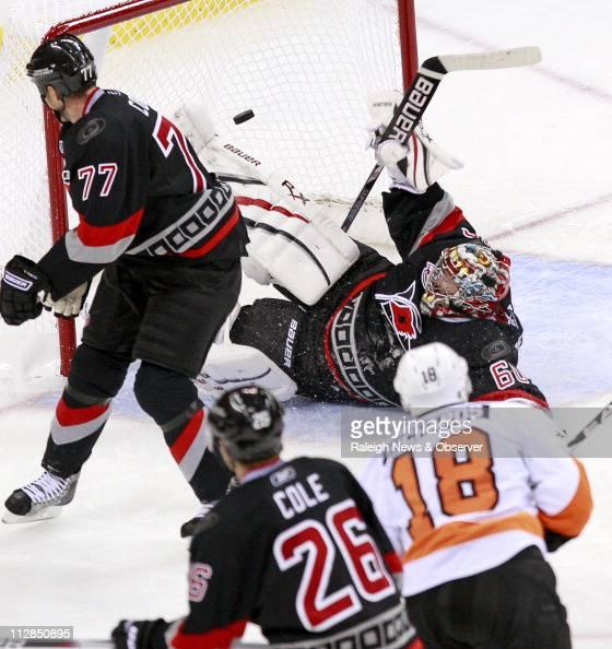 The Philadelphia Flyers' Mike Richards puts the puck past the Carolina Hurricanes' Joe Corvo Erik Cole and goalie Justin Peters for a thirdperiod...