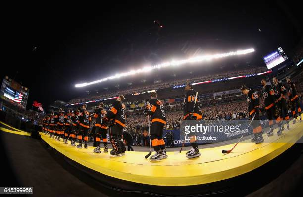 The Philadelphia Flyers stand for the singing of the National Anthem prior to the 2017 Coors Light NHL Stadium Series at Heinz Field on February 25...