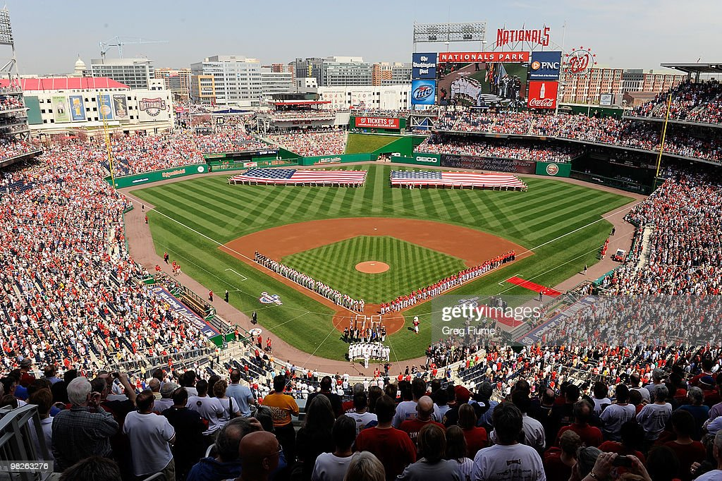 The Philadelphia Phillies and the Washington Nationals line up for the national anthem on Opening Day at Nationals Park on April 5 2010 in Washington...