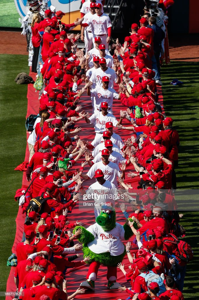 The Philadelphia Phillies are led onto the field by the Phillie Phanatic before the Opening Day game against the Kansas City Royals at Citizens Bank Park on April 5, 2013 in Philadelphia, Pennsylvania.