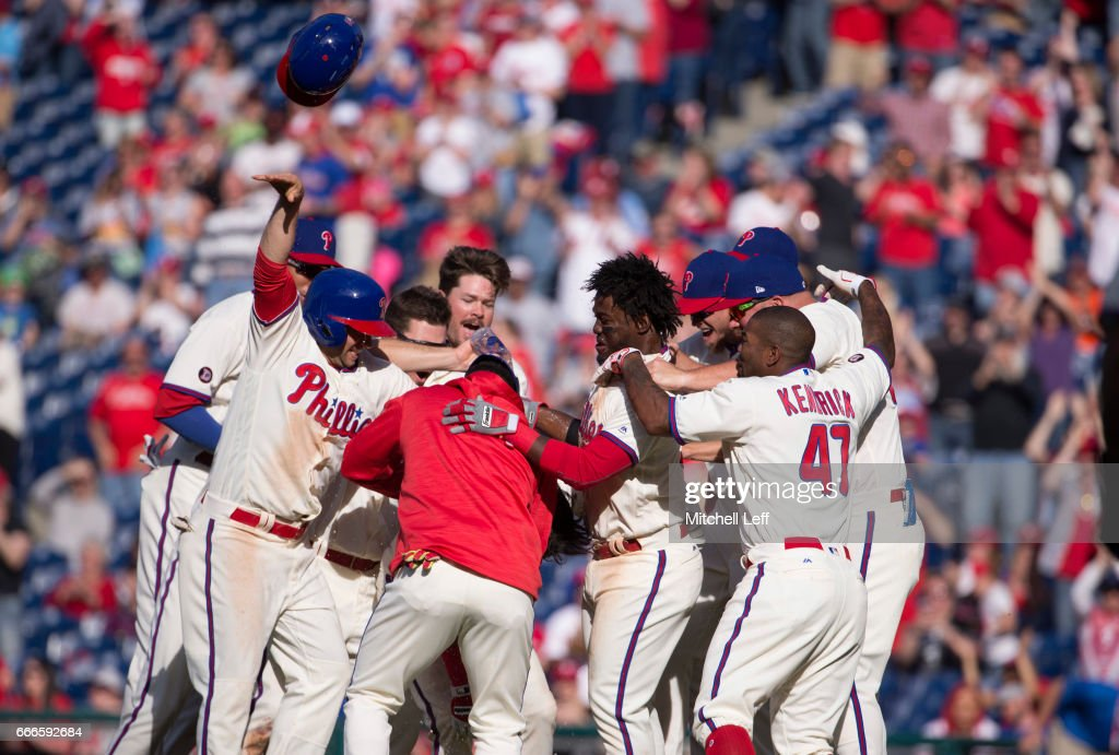 The Philadelphia Phillies celebrate after a walk off single hit by Cesar Hernandez #16 of the Philadelphia Phillies (NOT PICTURED) in the bottom of the ninth inning against the Washington Nationals at Citizens Bank Park on April 9, 2017 in Philadelphia, Pennsylvania. The Phillies defeated the Nationals 4-3.