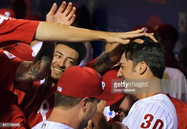 The Philadelphia Phillies congratulate teammate Cameron Perkins after hitting his first major league home run against the Miami Marlins at Citizens...