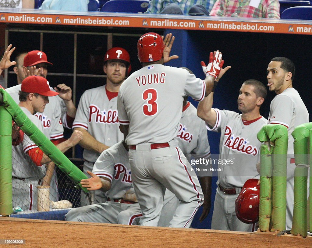 The Philadelphia Phillies' Delmon Young (3) celebrates in the dogout after hitting a home run in the fourth inning against the Miami Marlins at Marlins Park in Miami, Florida, on Tuesday, May 21 2013.