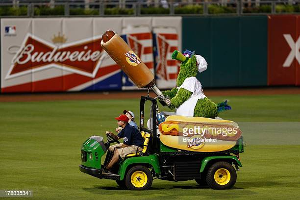 The Philadelphia Phillies mascot the Phillie Phanatic rides a Hatfield Hot Dog cart during the game against the Washington Nationals at Citizens Bank...