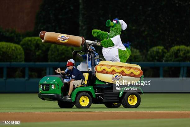 The Philadelphia Phillies mascot the Phillie Phanatic rides a Hatfield Hot Dog cart in the outfield during the game against the Washington Nationals...