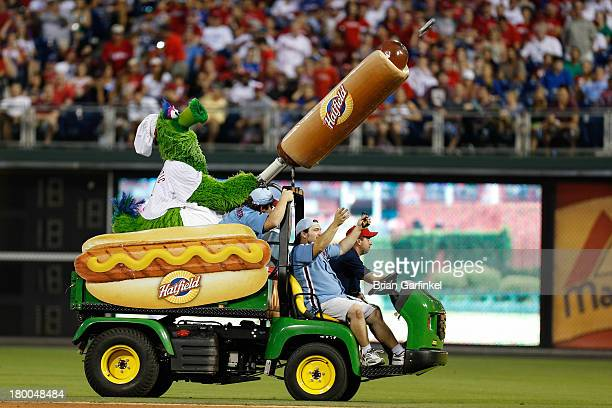 The Philadelphia Phillies mascot the Phillie Phanatic shoots a Hatfield Hot Dog into the stands during the game against the Washington Nationals at...