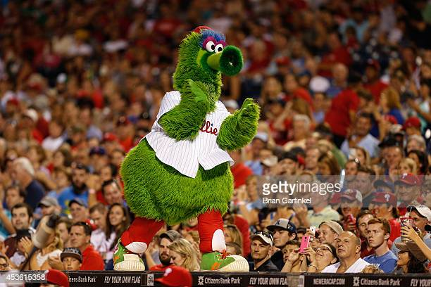 The Philadelphia Phillies mascot the Phillie Phanatic walks on top of the dugout in between innings of the game against the Arizona Diamondbacks at...