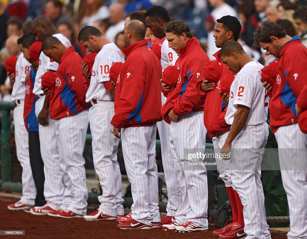 The Philadelphia Phillies observe a moment of silence for the victims of the Boston Marathon bombing before the game against the St. Louis Cardinals at Citizens Bank Park on April 18, 2013 in Philadelphia, Pennsylvania.