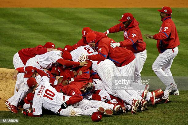 The Philadelphia Phillies pile on top of closing pitcher Brad Lidge after they won 43 to win the World Series against the Tampa Bay Rays during the...
