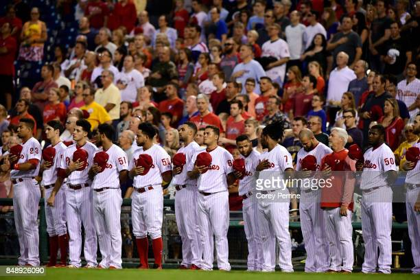 The Philadelphia Phillies stand for the national anthem before hosting the Oakland Athletics at Citizens Bank Park on September 16 2017 in...