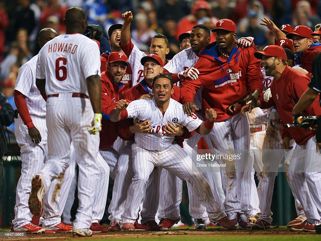 The Philadelphia Phillies wait at home plate for <a gi-track='captionPersonalityLinkClicked' href=/galleries/search?phrase=Ryan+Howard&family=editorial&specificpeople=551402 ng-click='$event.stopPropagation()'>Ryan Howard</a> #6 after he hit a walk-off three-run home run in the ninth inning against the Colorado Rockies at Citizens Bank Park on May 28, 2014 in Philadelphia, Pennsylvania. The Phillies won 6-3.