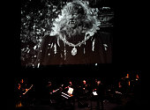 The Philip Glass Ensemble with Michael Riesman at the Edinburgh Playhouse to perform Philip Glass's music for accompany Jean Cocteau's film La Belle...