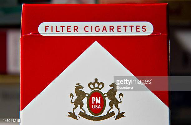 The Philip Morris International Inc logo is seen on a pack of Marlboro cigarettes displayed for a photograph in Tiskilwa Illinois US on Tuesday April...