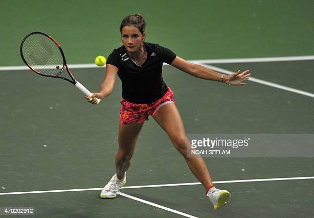 The Philippines' Katharina Lehnert returns to India's Ankita Raina in the Fed CupOceana Group II Tennis Championship final at Fateh Maidan Tennis...