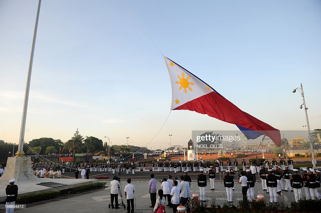 The Philippines national flag is raised during a wreath-laying ceremony on the 106th anniversary of Philippine national hero Jose Rizal at the Luneta Park in Manila on December 30, 2012. Rizal was sentenced to death by a firing squad of the Spanish army after he was accused of leading a revolution against Spain. AFP PHOTO / NOEL CELIS