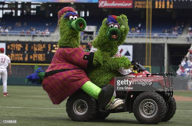 The Phillie Fanatic waves to the crowd as he takes his mom for a spin on his ATV on Mother's Day during the MLB game against the Arizona Diamondbacks...