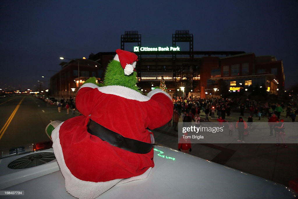 The Phillie Phanatic catches a ride on the roof of a fire truck to the Philadelphia Phillies Christmas tree lighting ceremony at Citizens Bank Park on Saturday December 15, 2012 in Philadelphia, Pennsylvania.