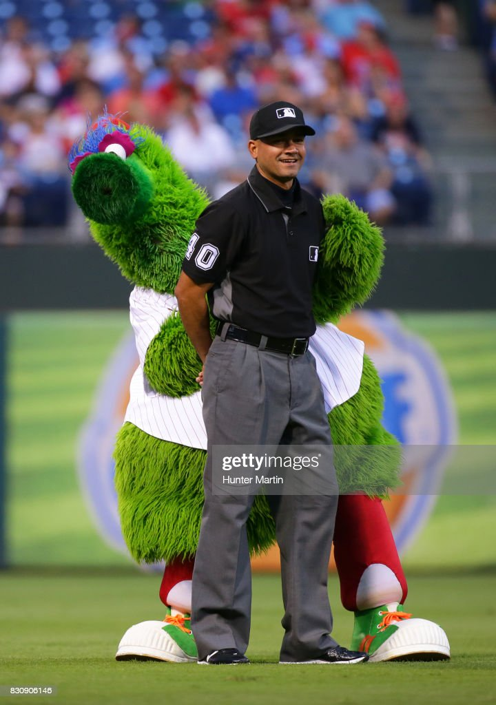 The Phillie Phanatic clowns around with umpire Roberto Ortiz before a game between the Philadelphia Phillies and the New York Mets at Citizens Bank Park on August 12, 2017 in Philadelphia, Pennsylvania. The Phillies won 3-1.
