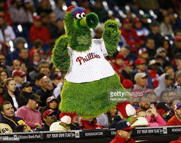 The Phillie Phanatic entertains during the fourth inning of a game against the Washington Nationals at Citizens Bank Park on April 11 2015 in...