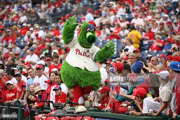 The Phillie Phanatic high fives some fans before a game against the Baltimore Orioles at Citizens Bank Park on June 21 2009 in Philadelphia...