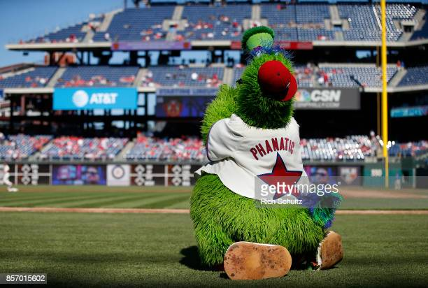 The Phillie Phanatic performs before a game between the New York Mets and the Philadelphia Phillies at Citizens Bank Park on October 1 2017 in...