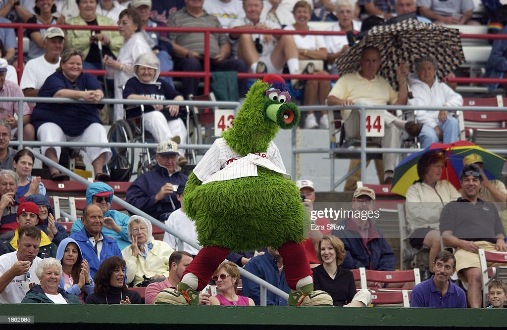 The Phillie Phanatic performs for the crowd during a spring training game between the New York Yankees and the Philadelphia Phillies in a spring...