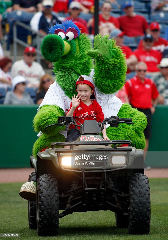 The Phillie Phanatic rides a young fan around on a 4 wheeler before a spring training game between the Philadelphia Phillies and the Boston Red Sox at Spectrum Field on March 12, 2017 in Clearwater, Florida.