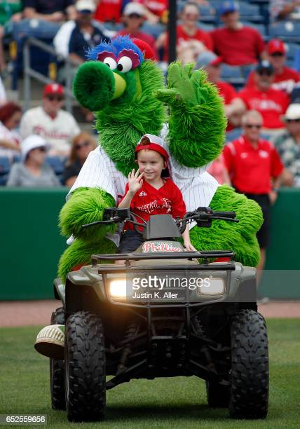 The Phillie Phanatic rides a young fan around on a 4 wheeler before a spring training game between the Philadelphia Phillies and the Boston Red Sox...