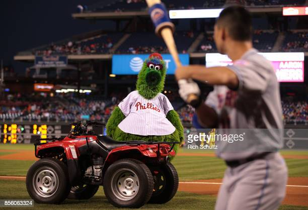 The Phillie Phanatic stares down Norichika Aoki of the New York Mets as stands in the on deck circle before his first at bat against the Philadelphia...