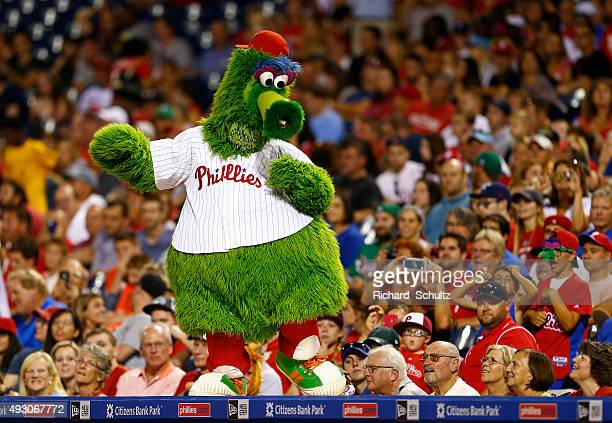The Philly Phanatic dances on the dugout during a game against the San Diego Padres at Citizens Bank Park on August 29 2015 in Philadelphia...