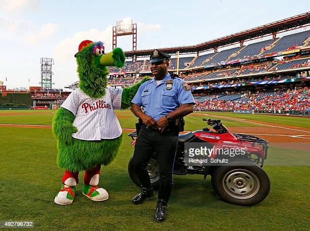 The Philly Phanatic engages a Philadelphia police officer before a game between the San Diego Padres and Philadelphia Phillies at Citizens Bank Park...