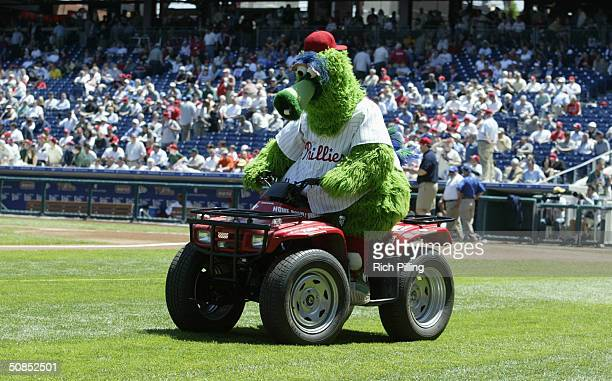 The Philly Phanatic rides at ATV during the game between the Philadelphia Phillies and the St Louis Cardinals at Citizens Bank Park on May 6 2004 in...