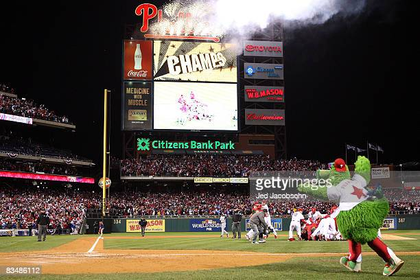 The Philly Phanatic runs on the field as the Philadelphia Phillies pile up on top of closing pitcher Brad Lidge after they won 43 wo win the World...