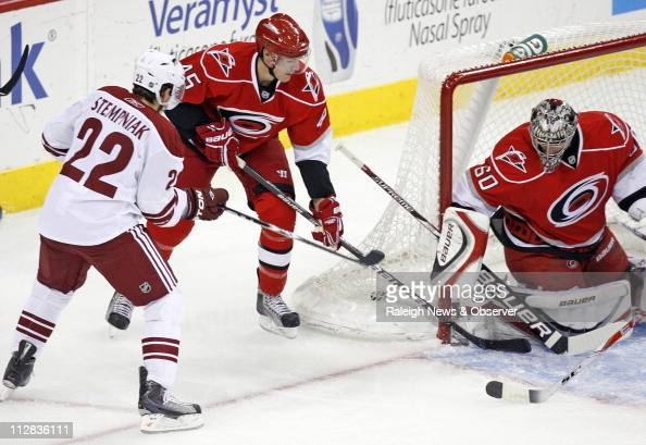 The Phoenix Coyotes' Anders Eriksson puts the puck past the Carolina Hurricanes' Alexandre Picard and goalie Justin Peters for a goal in the first...