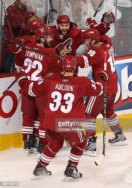 The Phoenix Coyotes celebrate after Vernon Fiddler scored a second period goal against the Detroit Red Wings in Game Seven of the Western Conference...