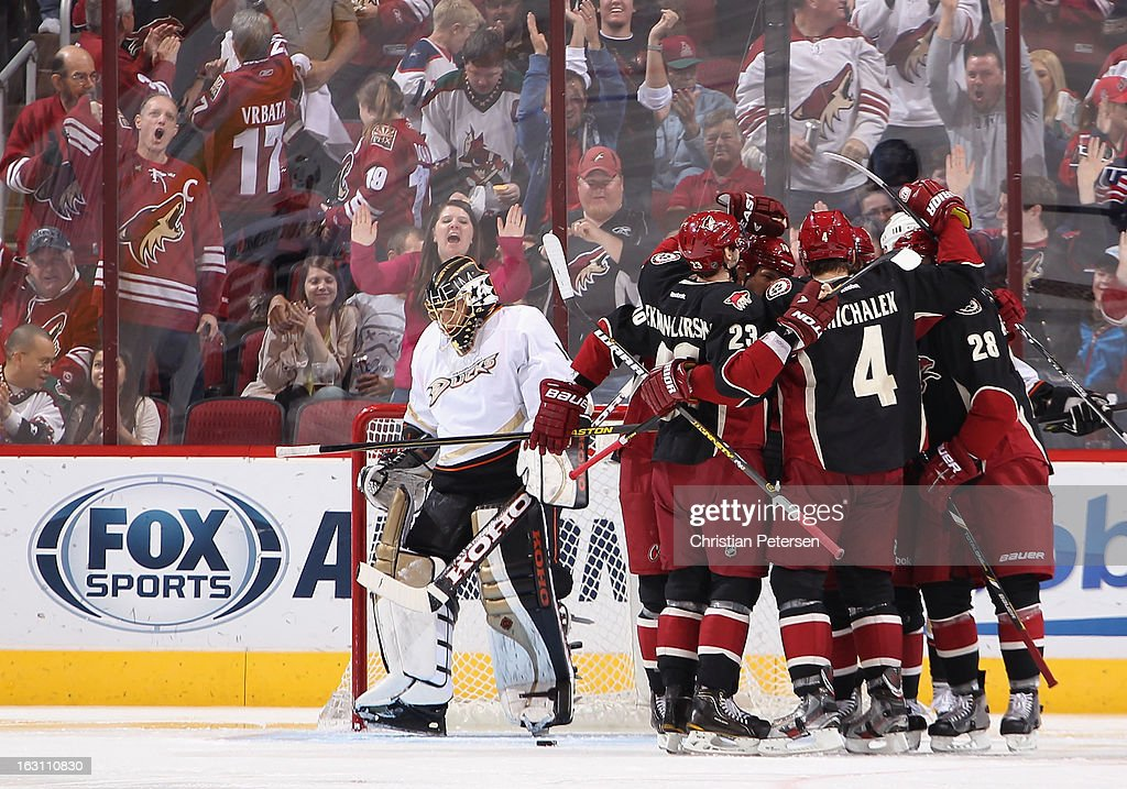 The Phoenix Coyotes celebrate around Antoine Vermette #50 after he scored a second period goal past goaltender Jonas Hiller #1 of the Anaheim Ducks during the NHL game at Jobing.com Arena on March 4, 2013 in Glendale, Arizona.
