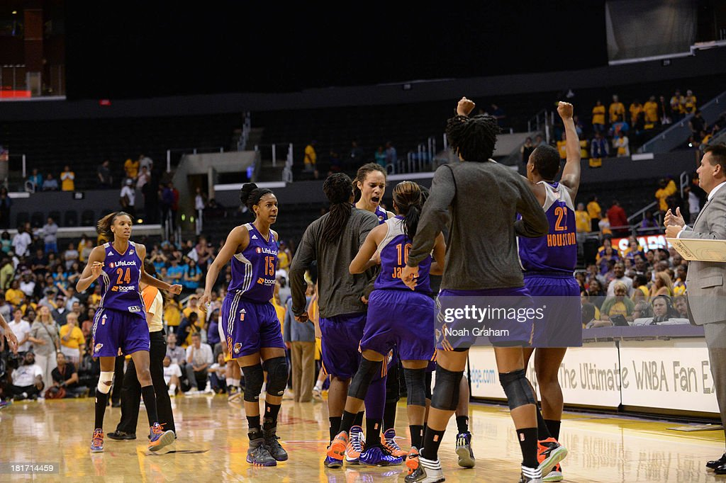 The Phoenix Mercury celebrate after taking a lead over the Los Angeles Sparks in Game Three of the Western Conference Semifinal of the 2013 WNBA playoffs at Staples Center on September 23, 2013 in Los Angeles, California.
