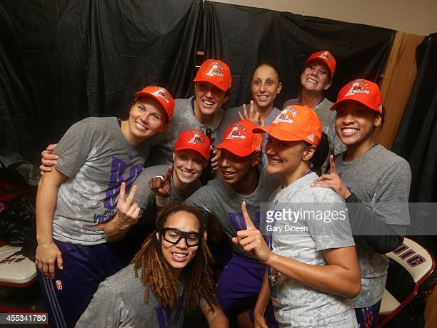 The Phoenix Mercury celebrate in the locker room following Game Three of the 2014 WNBA Finals on September 12 2014 at the UIC Pavilion in Chicago...