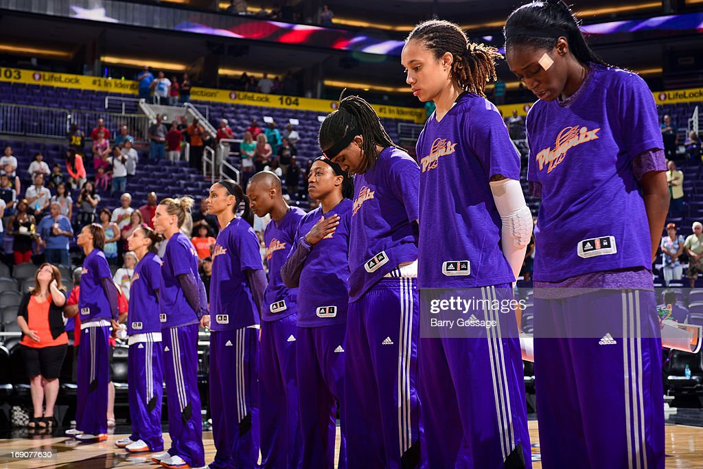 The Phoenix Mercury listen to the National Anthem before playing against the Japanese National Team during a WNBA preseason game on May 19, 2013 at U.S. Airways Center in Phoenix, Arizona.