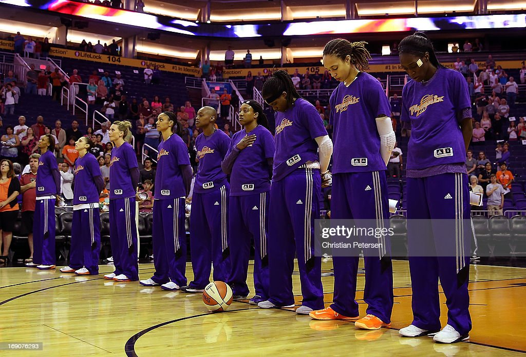 The Phoenix Mercury stand attended for the National Anthem before the preseason WNBA game against Japan at US Airways Center on May 19, 2013 in Phoenix, Arizona.