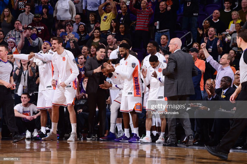 The Phoenix Suns celebrate as they play against the San Antonio Spurs on December 9, 2017 at Talking Stick Resort Arena in Phoenix, Arizona.