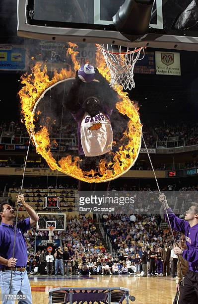 The Phoenix Suns Gorilla jumps through the Ring of Fire before dunking during a break in the game against the Los Angeles Lakers at America West...