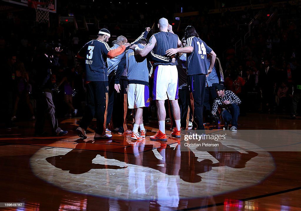The Phoenix Suns huddle up before the NBA game against the Milwaukee Bucks at US Airways Center on January 17, 2013 in Phoenix, Arizona. The Bucks defeated the Suns 98-94.