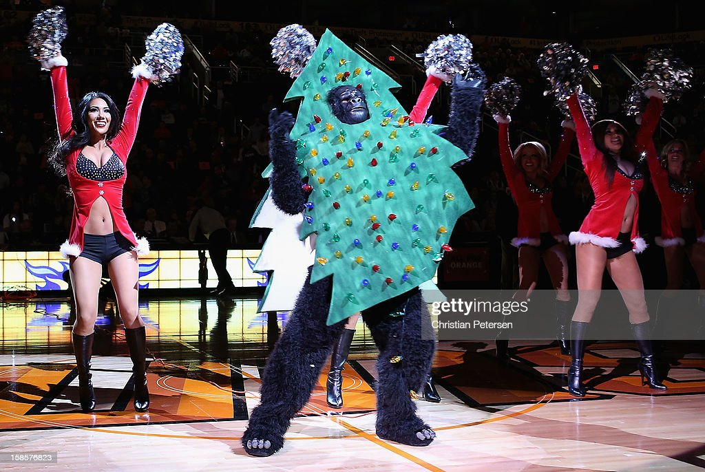 The Phoenix Suns mascot, Gorilla, performs with cheerleaders before the NBA game against the Charlotte Bobcats at US Airways Center on December 19, 2012 in Phoenix, Arizona.