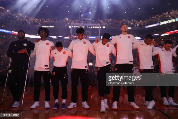 The Phoenix Suns stand together for the national anthem to the NBA game against the Portland Trail Blazers at Talking Stick Resort Arena on October...